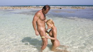 Busty beach nymph