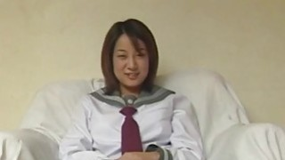 Sultry schoolgirl Aizawa spreads her pink pussy wide on a couch