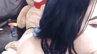 Tattooed teen riding a fake cock