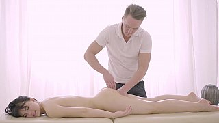 Brunette enjoys a deep drilling on a massage table