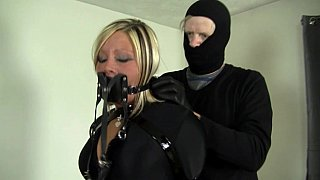 Slave in latex bondage